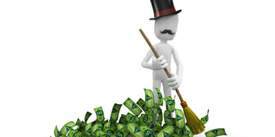 Capitalist sweeping money.